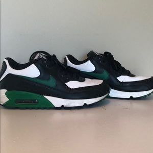 Black, green and white Nike Air Max 90s.